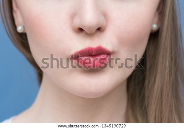 The face of a beautiful woman, pout lips, playful woman, close up, the concept of human emotion