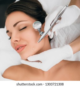 face of beautiful woman while procedure jet peeling, facial treatment