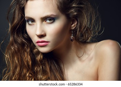 Face of a beautiful young woman with bright makeup