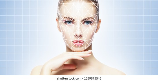 Face of a beautifyl girl with a scnanning grid on her face. Face id, security, facial recognition, authentication technology.