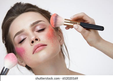 Face Beauty Cosmetics. Portrait Of Beautiful Young Female With Fresh Skin And Natural Makeup. Closeup Of Sexy Glamourous Woman Applying Pink, Orange Loose Powder Blush On Facial Skin. High Resolution