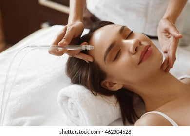 Face Beauty Treatment. Closeup Of Beautiful Woman Getting Facial Gas-liquid Oxygen Water Epidermal Peeling Using Professional Equipment At Cosmetology Center. Skin Care Concept. High Resolution Image