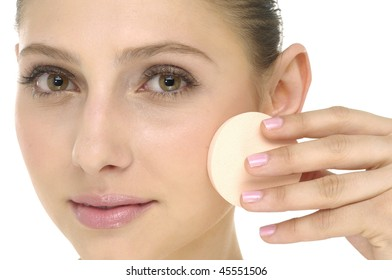 face of beauty young woman applying face foundation