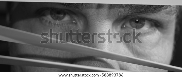 Face behind blinds