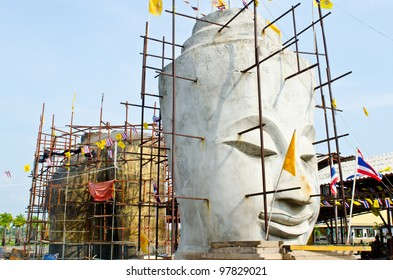 Face of buddha with blue sky, Thailand.