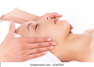 Face of calm female during procedure of facial massage