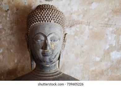 Face of a centuries old Buddha image.