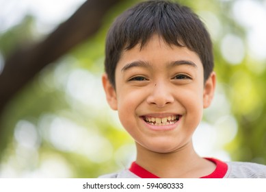 Face close up of boy mix race smiling