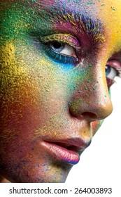 Face with colorful makeup closeup