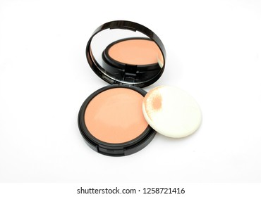 Face compact makeup powder with mirror on white background