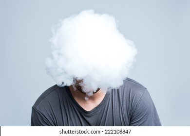 Face covered with thick white smoke isolated on light background