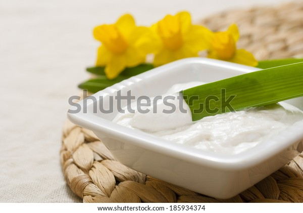 face cream with daffodils