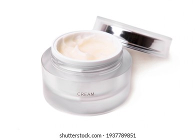 Face cream in a jar isolated on white background.