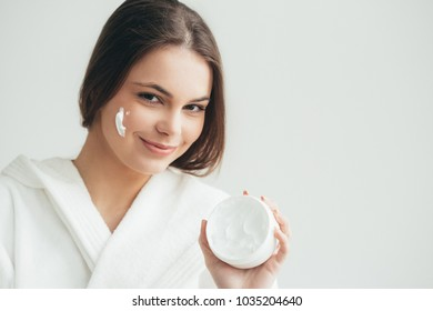 Face cream woman applying crean on skin natural portrait
