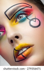 Face with creative makeup closeup
