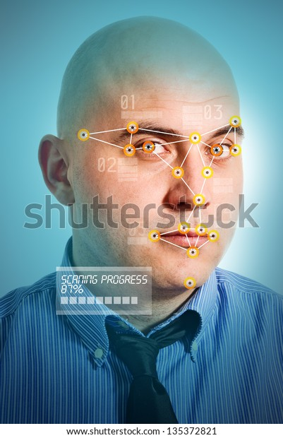 Face detection software recognizing a face of young adult bald businessman.