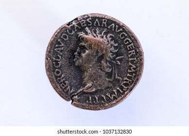 The face of an emperor on a Roman coin