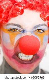 Face Of A Entertainer Clown Throwing A Fit Of Red Clown Rage Isolated On A White Background