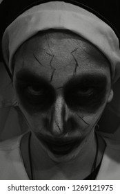 Face of errifying nun on Halloween night. Nun of evil. Murder nun.