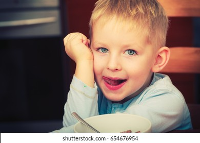 Face expressions, children concept. Portrait of happy kid boy looking straight to camera