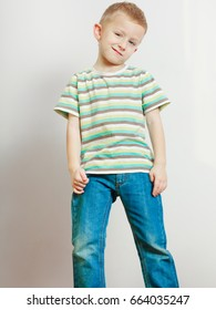 Face expressions, children fashion concept. Portrait of happy kid boy looking straight to camera