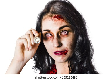 Face of a fearful woman in zombie make up holding flashlight in hand. Halloween hide and seek concept over white