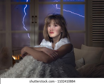 The face of a frightened young girl in tears. The window in the room, lightning, weather. Conceptually fear of thunderstorms, phobias, night terrors