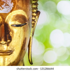 Face of gold buddha statue