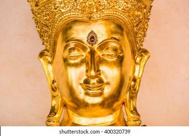 Face of golden buddha sculpture, Thailand