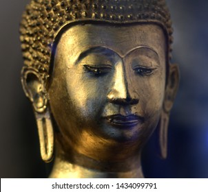 The face of the golden Buddha statue in the temple