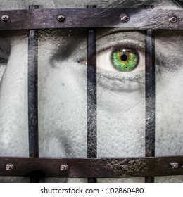 Face with green eye and painted Prison to show a prisoner of his own thoughts