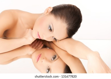 face and hands of beautiful woman with mirror