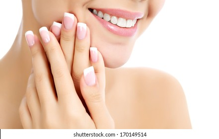 Face, hands and healthy white teeth of a woman, white background, copyspace.