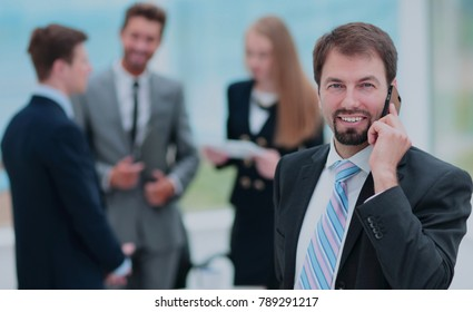 Face of handsome businessman on the background of business peopl