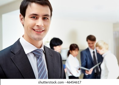 Face of handsome businessman in working environment