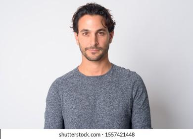 Face of handsome Hispanic man looking at camera
