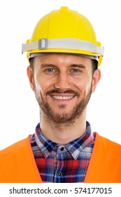Face of happy young man construction worker smiling