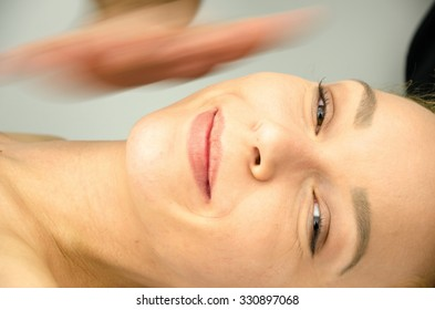 Face and head massage at the massage table