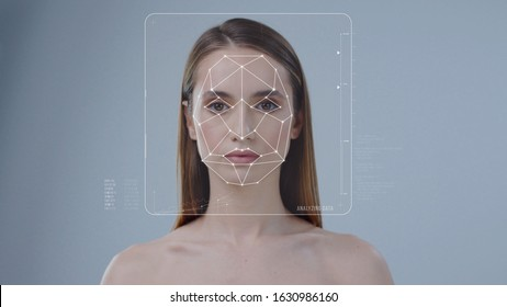 Face ID. Face Detection. 3D Facial Recognition. Technological Futuristic Biometric Scanning of Face of Beautiful Woman Isolated on Background. Concept of Personal Safety and Security.