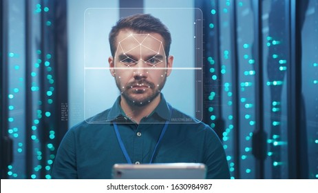 Face ID. Face Detection. Biometric Facial Recognition. ID Information Security. 3D Scanning of Face of Bearded Server Specialist Man Working with Tablet at Data Center. Data Analyzing Animation with