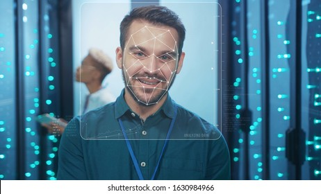 Face ID. Face Identification. Face Detection with 3D Animation. Biometric Future Scanning of Face of Happy IT Specialist Working in Server Room Data Center. Augmented Reality. Cyber Security and