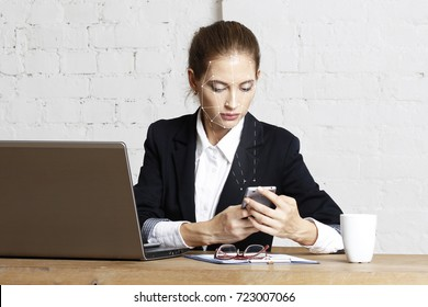 Face identification of business woman with phone. Biometric verification woman face recognition security.