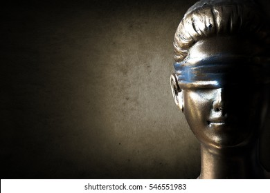 Face of Lady Justice in dark grunge brown background