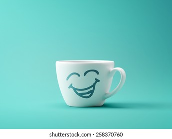 Face Laughing Coffee Cup Concept isolated on cyan background