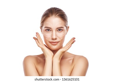 Face Lifting. Portrait of gorgeous and young woman with fresh clean skin and lifting arrows over her face. Isolated on white background. Cosmetic Medicine. Anti aging treatment.