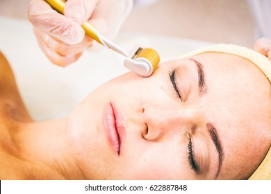 Face Lifting. Young woman.Face Skin Care. Lifting Procedure. Cosmetology Salon. Cosmetology Face Massage.
