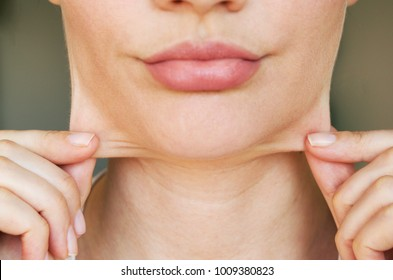 face line correction. a woman with a second chin