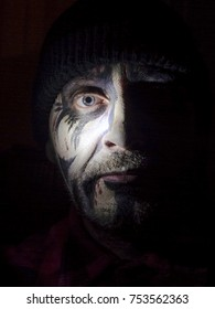 Face of a man with black metal mask - self-portrait
