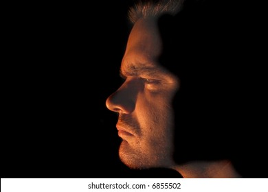 face of man in the dark