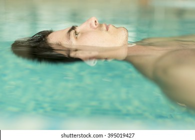 Face of the man floating in the pool